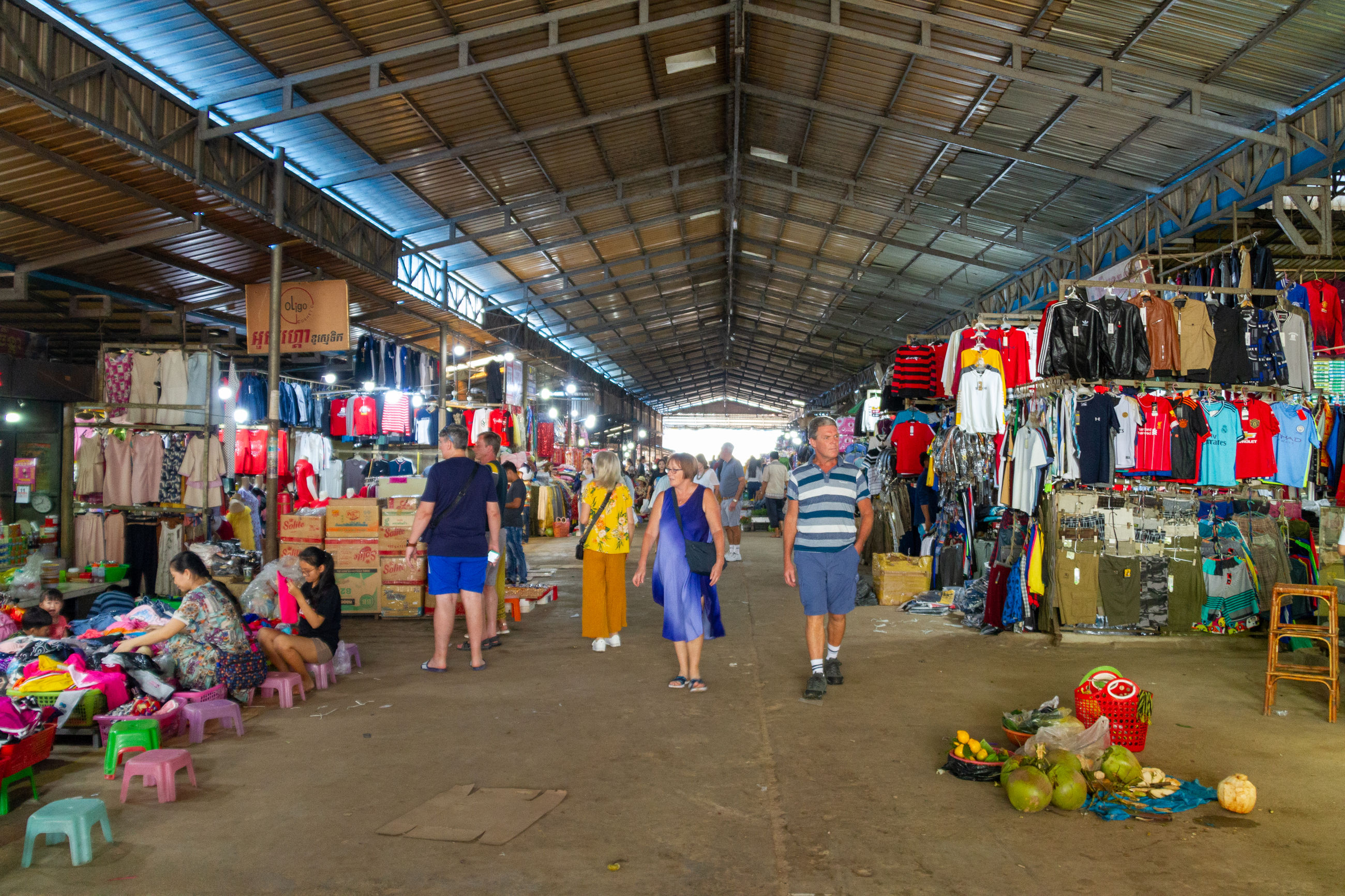 group of people, indoors, large group of people, women, adult, real people, crowd, men, architecture, market, retail, choice, walking, shopping, full length, business, day, large group of objects, lifestyles, ceiling