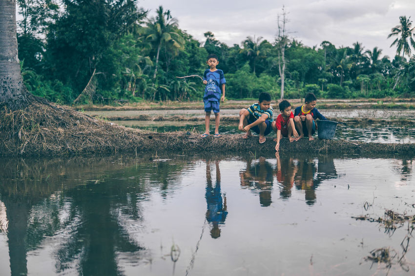 Fishing Time Boys Child Childhood Day Fishing Friendship Full Length Kid Leisure Activity Lifestyles Nature Outdoors People Real People Rural Scene Togetherness Tree Unity Vacations Water The Secret Spaces The Street Photographer - 2017 EyeEm Awards