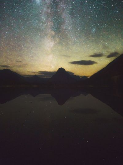Scenic view of silhouette mountain against sky at night