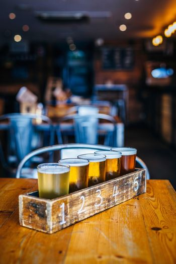 Beer glasses in flight on table in bar