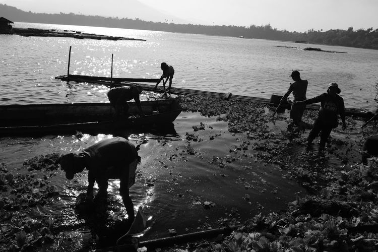 Blackandwhite Bnw Streetphotography Travel Photography Travel Silhouette People Water Men Real People Transportation Domestic Animals Occupation Full Length Mammal Outdoors Nature Day Nautical Vessel Sky Working Lake Fujifilm Fujifilm_xseries EyeEmNewHere