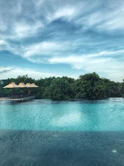 Water Sky Tree Cloud - Sky Scenics Sea Nature Beauty In Nature Tranquil Scene Tranquility Tourist Resort Outdoors No People Vacations Waterfront Day Built Structure Swimming Pool Luxury Architecture