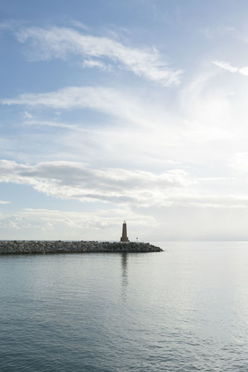 Puerto Banus SPAIN Minimal Minimalism Water Sky Sea Waterfront Cloud - Sky Tranquil Scene Tranquility Beauty In Nature Scenics - Nature Day Travel Nature No People Travel Destinations Architecture Tourism Reflection Built Structure Outdoors Lighthouse Lighthouses