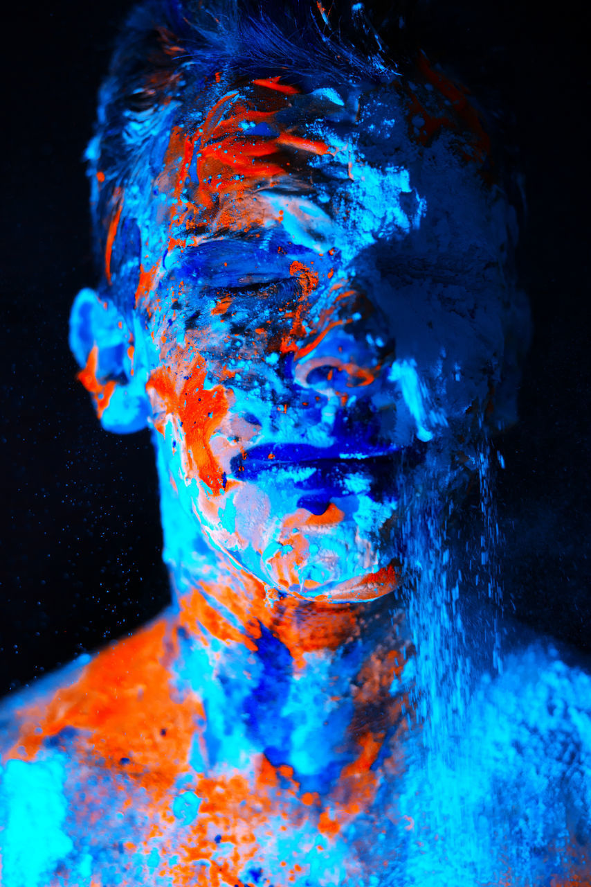 studio shot, black background, blue, multi colored, motion, indoors, one person, paint, creativity, water, portrait, vibrant color, adult, headshot, art, abstract, futuristic, ink, close-up, painting, young adult, splashing