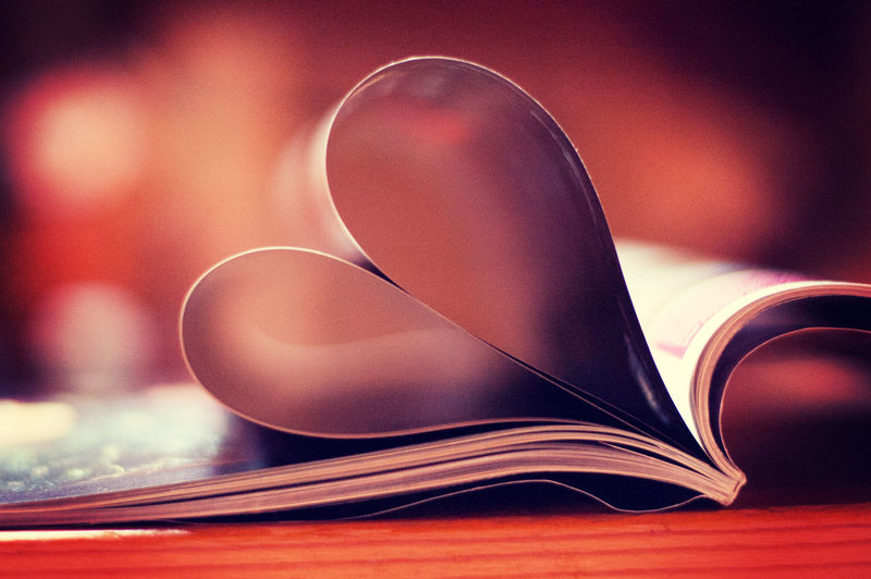 Close-Up Of Heart Shape Pages Folded In Book