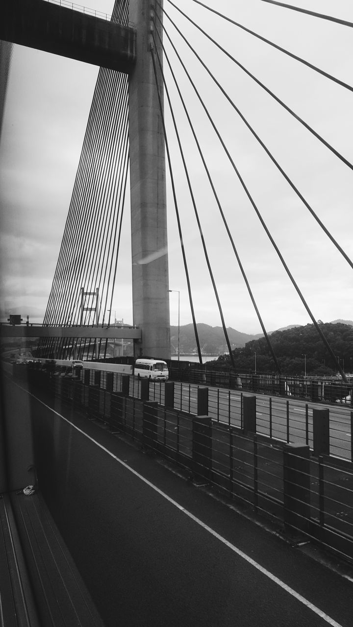 bridge - man made structure, connection, suspension bridge, engineering, architecture, built structure, transportation, bridge, outdoors, travel destinations, travel, river, cable, city, sky, no people, road, modern, day, skyscraper, line