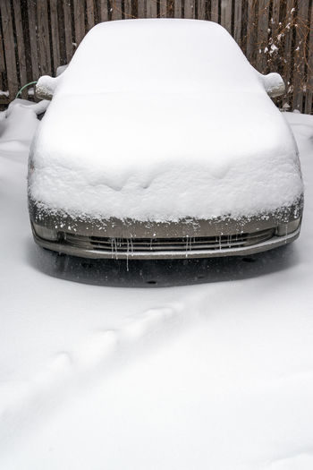 Car covered in snow in a blizzard in Chicago Building Car Chicago City Cityscape Cold Color Contemporany Covered Destination Donwtown Downtown Dusk Illinois Outdoors Season  Snow Structure Towers Travel United States Urban USA White Winter
