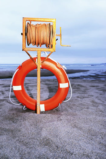 life buoy ring buoy in the beach at dawn Assistance Beach Beach Day Beach Life Beach Photography Beach View Concept Concept Security Conceptual Conceptual Photography  Danger Emergency Emergency Equipment Life Buoy Lifeguard  Lifeguard Hut Lifeguard Stand Lifesaver Rescue Rescue Equipment Ring Ring Buoy Safety Safety Equipment Security