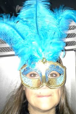 Mask - Disguise Looking At Camera Eye Mask Portrait Front View Costume Young Adult Venetian Mask One Person Feather  Young Women Lifestyles Disguise Leisure Activity One Young Woman Only Real People Headshot Day Women Indoors  New Orleans Niece