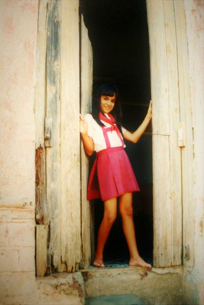 Portrait Looking At Camera One Person Standing Doorway Smiling People Day Old Vintage Door Outdoors Cuba Cuban Lifestyle School Uniforms Around The World School Uniform Santa Clara Santa Clara Cuba