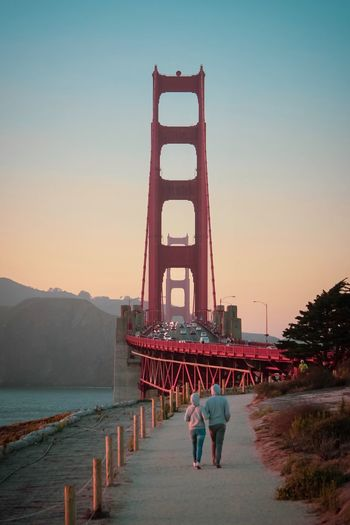 Red Bridge Golden Gate Bridge San Francisco Sky Architecture Built Structure Clear Sky Water Nature Real People Travel Destinations Travel Tourism Men Transportation Sunset Group Of People Full Length Building Exterior Copy Space Adult Large Group Of People Bay A New Beginning