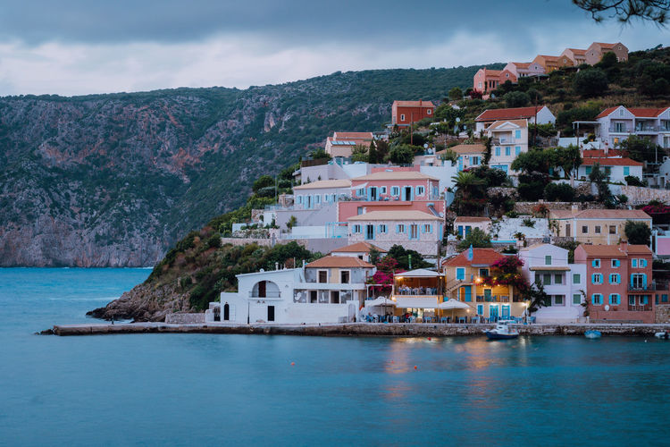 Houses on hill by sea