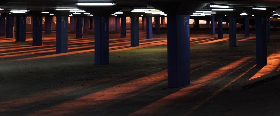 Empty parking garage at dusk Shadow Parking Garage Public Transportation