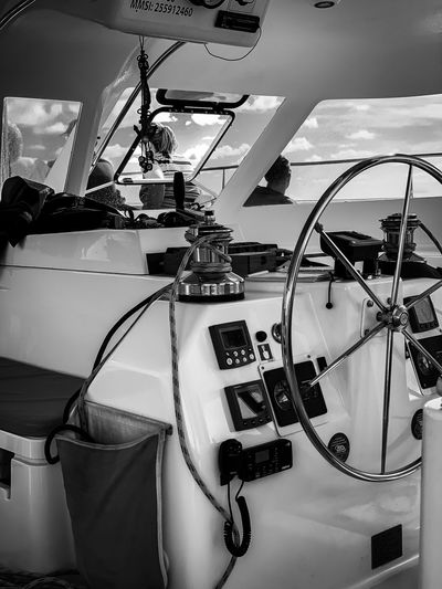 Close-up of steering wheel in sailboat