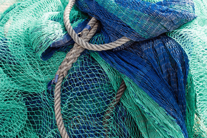 Fivedaysporto Fishing Net Full Frame Blue Fishing Industry Fishing Pattern No People Backgrounds Commercial Fishing Net Rope Day Close-up High Angle View Textured  Still Life Netting Complexity Outdoors Turquoise Colored Tangled Green Color Strength Equipment Fishing Boat