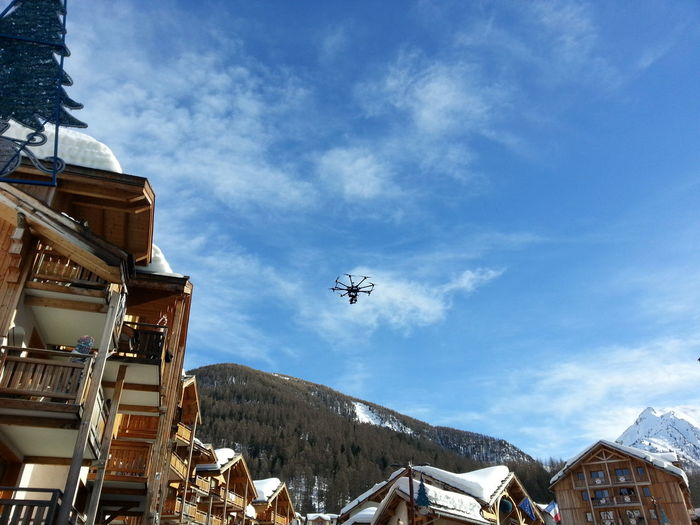 Low angle view of drone flying over village