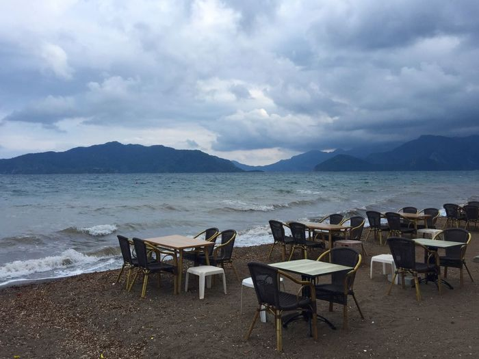Empty terrace cafe by the sea and stormy weather in Marmaris, Turkey Beautiful Blog Cafe Emtpy Furniture Marmaris Nature Restaurant Romantic Diner Romantic Dinner Scenery Sea Spring Storm Cloud Tourism Tourism Destination Tourist Tourist Attraction  Travel Travel Blog Travel Destinations Turkey Windy