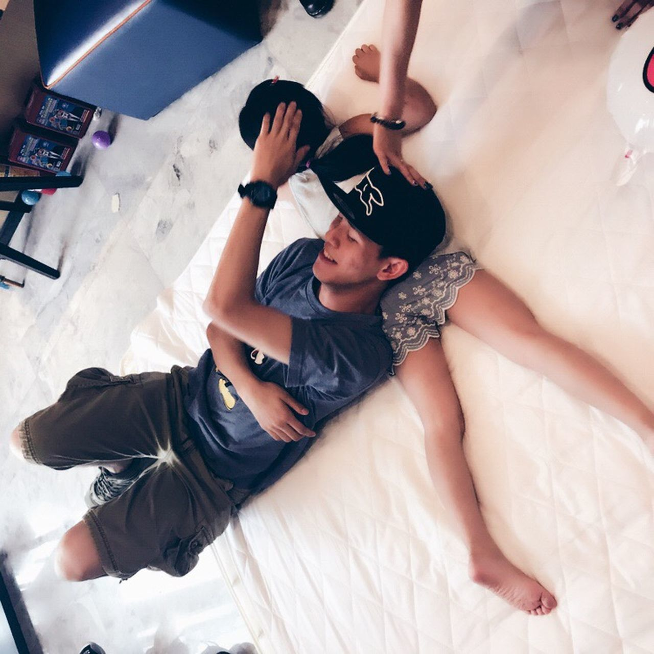 real people, two people, bed, high angle view, lying down, full length, togetherness, lying on back, young women, lifestyles, indoors, leisure activity, young adult, bedroom, day