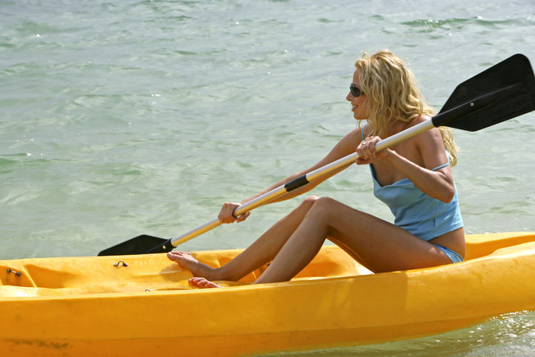 Pretty woman using seakayak Fun Holidays Summer Holidays Woman Action Boat Day Girl Leisure Leisure Activity Nature One Person Outdoors People Sea Seakayak Seakyaking Summer Water Young Adult