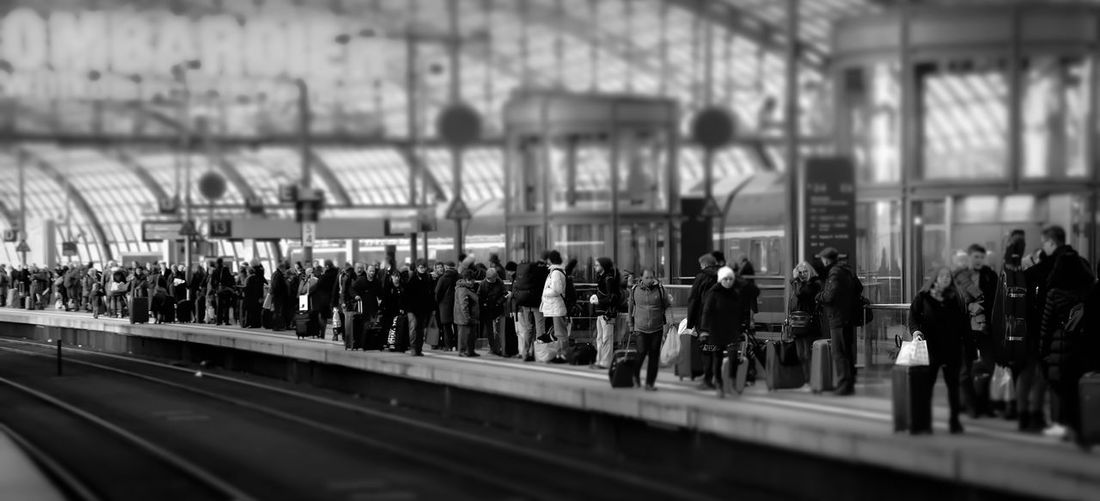 Panoramic View Of People Waiting At Railroad Station