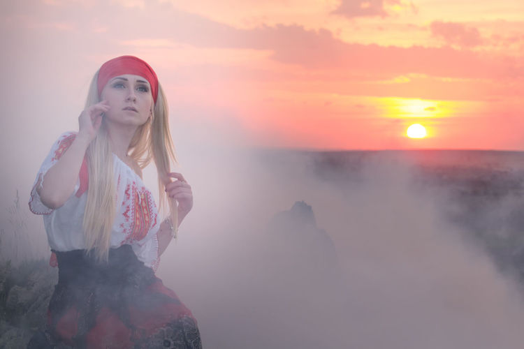 Fashion Lifestyle Nature Attractive Beautiful Woman Blonde Hair Blouse Caucasian Creative Freedoom  Landscape Lifestyles Magic Model Outdoors Portrait Pretty Red Scarf Scenics - Nature Sky Summer Sunset Traditional White Smoke Young Adult