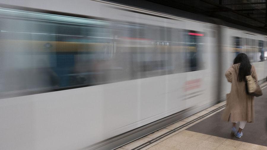 Woman on train at railroad station platform