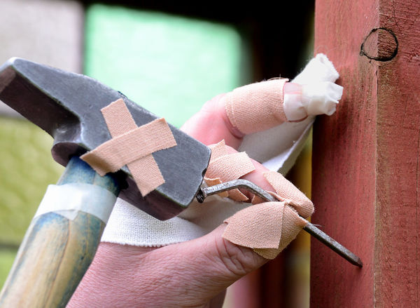 All thumbs DIY'er with very bad luck Bad Luck DIY Accidents And Disasters All Thumbs Architecture Band Aid Building Exterior Close-up Day Hammer Holding Human Body Part Human Finger Human Hand Injury Metal Nail One Person Outdoors Plaster Real People