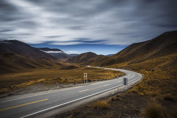 Mountain road of Lindiss Pass in South Island, New Zealand Autumn Beauty In Nature Cloud - Sky Highway Landscape Lindiss Pass Long Exposure Mountain Mountain Road Nature New Zealand No People Outdoors Road Scenics Sky The Way Forward Winding Road