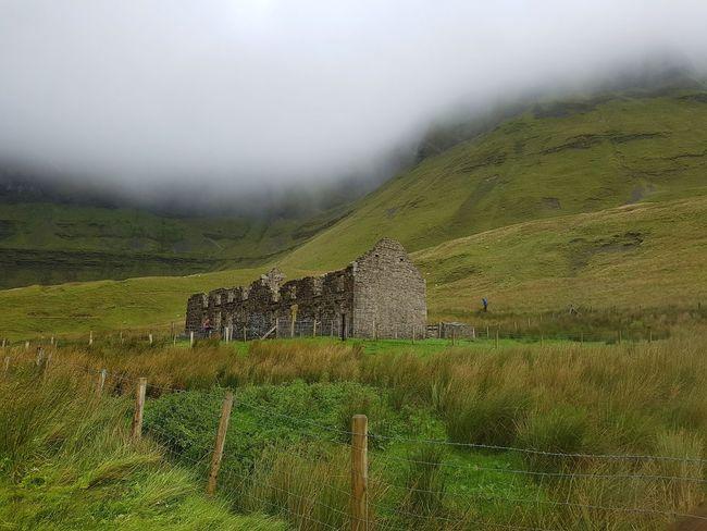 Oldl building in Gleniff horseshoe drive, Sligo, Ireland. Landscape Green Dramatic Cloudy Rural Scene