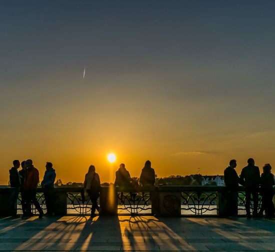 Sunset and silhouette Sunset Sky Outdoors Sun People Large Group Of People Cloud - Sky Full Length Travel Destinations Friendship Water City Adult