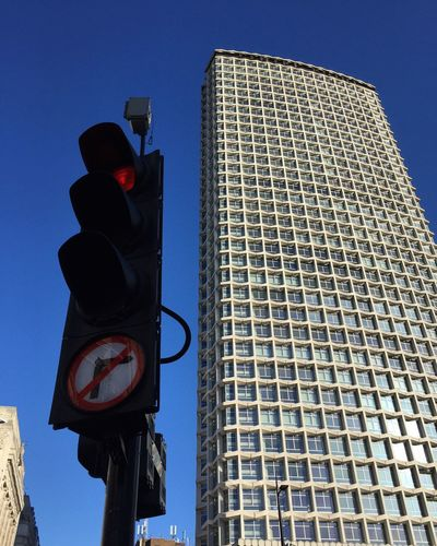 Centrepoint and a traffic light Oxford Street  Lunch Time! No Right Turn Skyscraper Traffic Lights Sign Communication Low Angle View Sky Road Sign Built Structure Architecture Building Exterior City Blue Clear Sky Day Building No People Tall - High