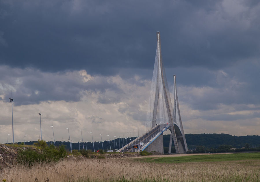 The Normandy Bridge, France Agriculture Cloud - Sky Cloudscape Countryside Day Engineering Environmental Conservation Famous Place Field France Landscape Nature No People Non-urban Scene Outdoors Remote Rural Scene Scenics Sky Solitude Storm Cloud The Normandy Bridge Tranquil Scene Tranquility