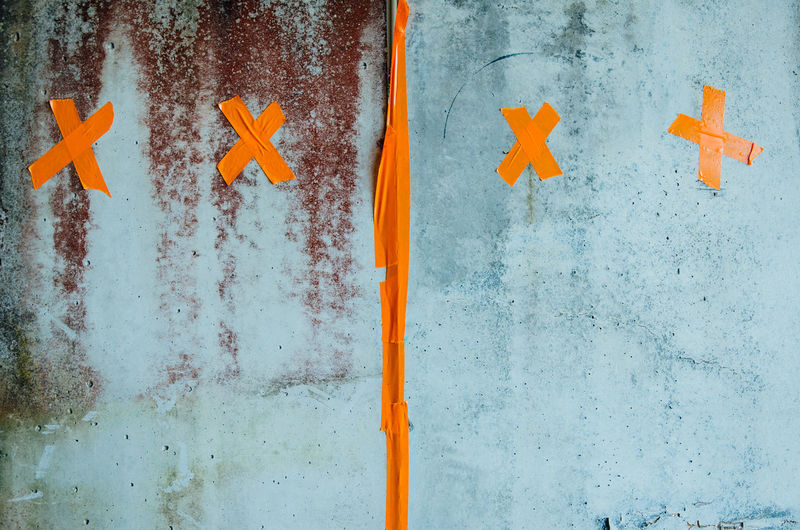 Close-up of wall with orange tape