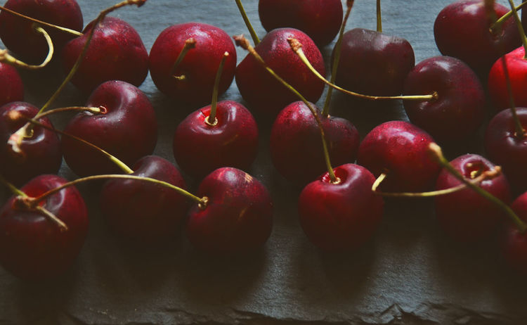 cherries on black background Cherries Cherry Dark Red Accent Background Black Close-up Dark Food Photography Day Food Food And Drink Fresh Freshness Fruit Healthy Eating Indoors  No People Photography Red Stone Tasty Yummy