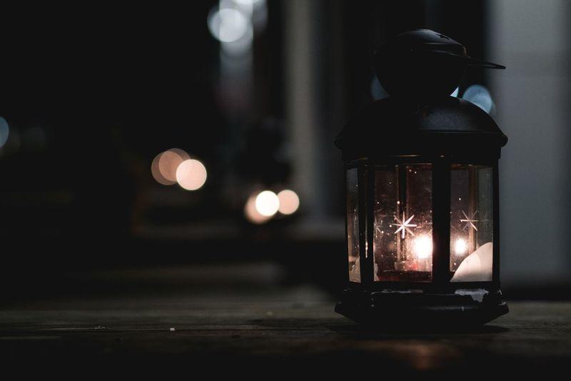 Illuminated Lantern On Table