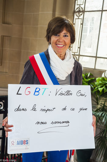 Paris, France, Portrait French People Holding Signs with Anti Homophobia Slogans Casual Clothing Confidence  Day Discrimination Front View Leisure Activity Lgbt Lifestyles Portrait Sign Toothy Smile Woman Portrait