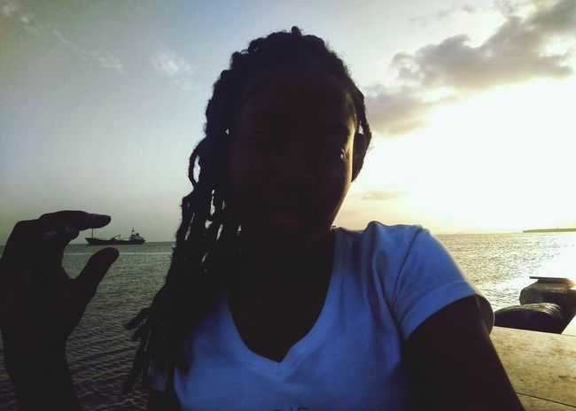 catch a boat, capture the sunset! Woman Of EyeEm Young Woman Rastagirl Portrait Of A Woman Selfie ✌ Trinidad And Tobago Caribbean The Photojournalist - 2018 EyeEm Awards Water Beach Portrait Sea Headshot Front View Human Face Sand Silhouette Sunset Horizon Over Water Idyllic Ocean Tranquil Scene Dramatic Sky Evening Shore Cloud - Sky Calm Outline