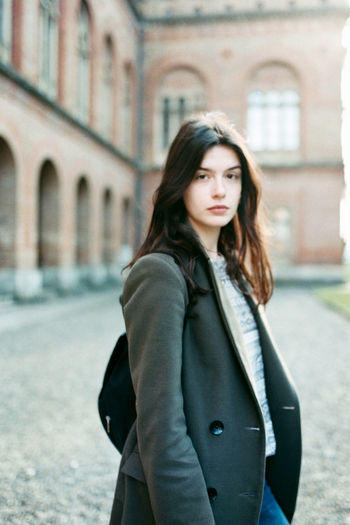 Adult Architecture Beautiful Woman Beauty Building Exterior Built Structure City Contemplation Focus On Foreground Hair Hairstyle Lifestyles Long Hair One Person Outdoors Real People Standing Three Quarter Length Warm Clothing Women Young Adult Young Women