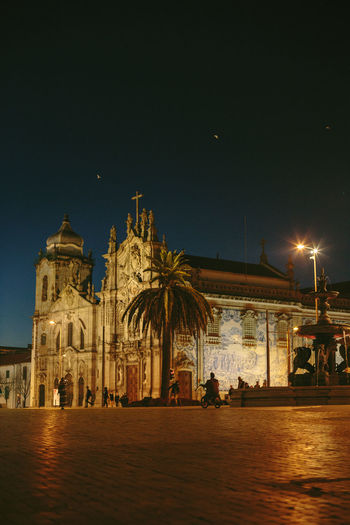 View of illuminated temple against clear sky at night