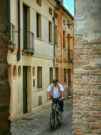 Treviso, Italy Traveling Italy Treviso Photography Art Fineart Urban Architecture Historical Buildings Arcades City Bikers