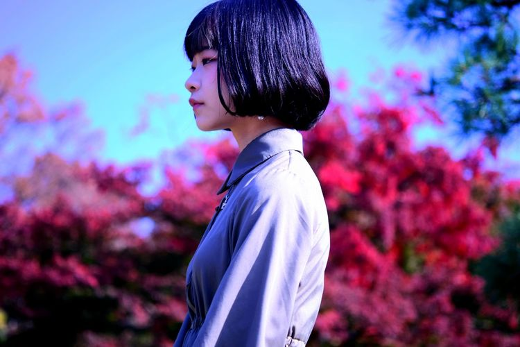 Side view of woman with short hair looking away