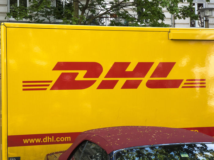 DHL delivery van. Dhl is global market leader in logistics industry. It commits its expertise in international parcel, express, air and ocean freight, road and rail DHL Express Delivery Delivery Service Delivery Van Car Close-up Deliver Delivering Delivery Truck Dhl Land Vehicle Mode Of Transportation Motor Vehicle No People Sign Transportation Yellow