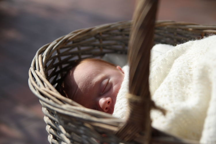 Close-Up Of Baby Sleeping In Basket