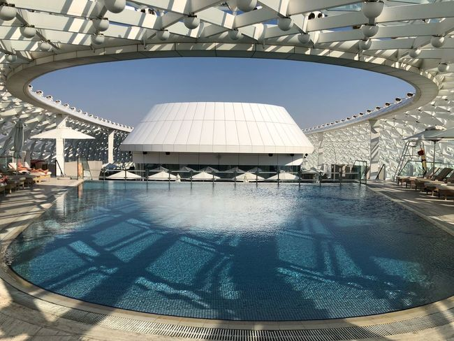 Swimmingpool YasViceroy YasMarinaCircuit Swimming Pool Reflection Water Day Architecture Built Structure Large Group Of People Vacations