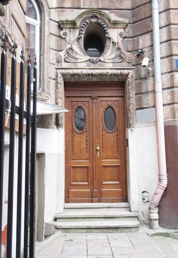 Beautiful wooden door in an old building. Krakow. Poland. Old Building. Beautiful Arch Architecture Building Exterior Built Structure Close-up Closed Day Door Doorway Entrance Entry No People Outdoors Wooden