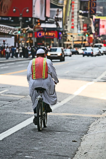 42nd Street City Cityscape Cycling Men Multi Cultural One Man Only One Person Outdoors People Road Street Transportation Travel Destinations Safety First! Safety First Bicycle Bicycle Trip Bicycling Adapted To The City TCPM The Street Photographer - 2017 EyeEm Awards BYOPaper! Stories From The City Adventures In The City