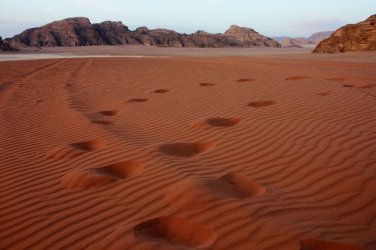 Arid Climate Arid Landscape Barren Beach Bedou Copy Space Deser Desert FootPrint Geology Geometry Jordan Physical Geography Remote Rough Sand Sand Dune Shore Summer Tranquil Scene Unrecognizable Person Vacations Wadi Rum