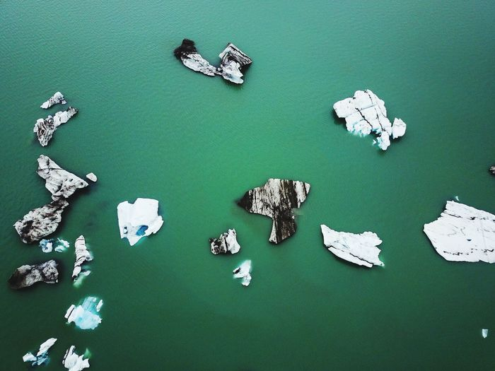 High angle view of icebergs in sea