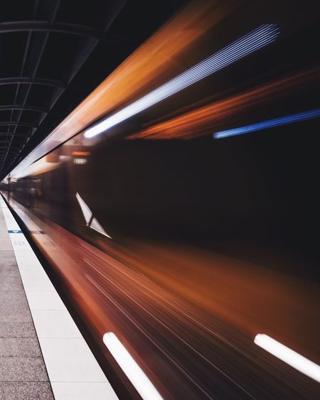 Blurred motion of train at subway station
