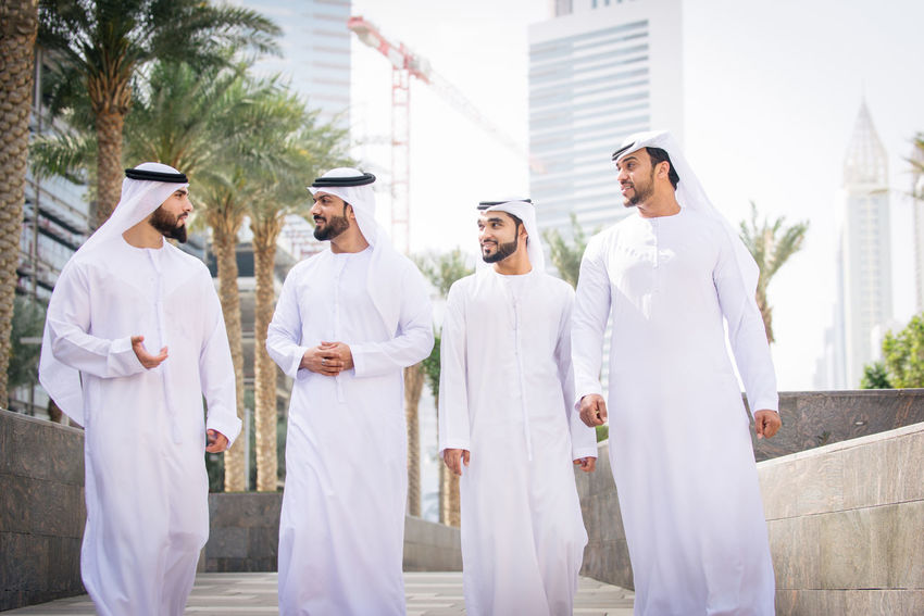 Group of arabian businessmen with traditional dress Arabian Business Dress Meeting Meeting Friends Middle East Traditional Clothing UAE Arabic Businessmen Businesspeople Formal Friendship Gulf Islamic Kandora Kandura Men Middle-eastern Muslim Outdoors People Wear White